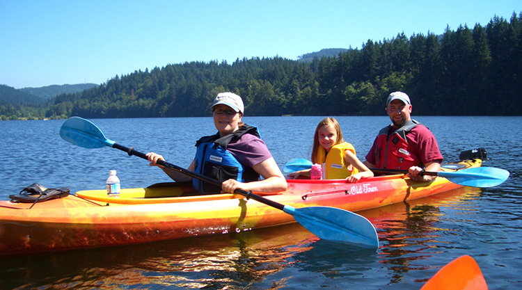 Family on a Inflatable Kayak with fun